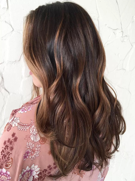 dark brown medium length hairstyles 2017 with caramel highlights
