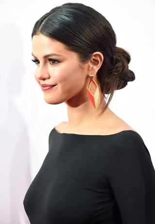 low sleek bun with an edge medium hairstyles 2016